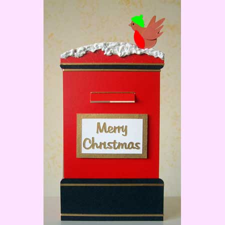 Post box with Merry Christmas sign on the front